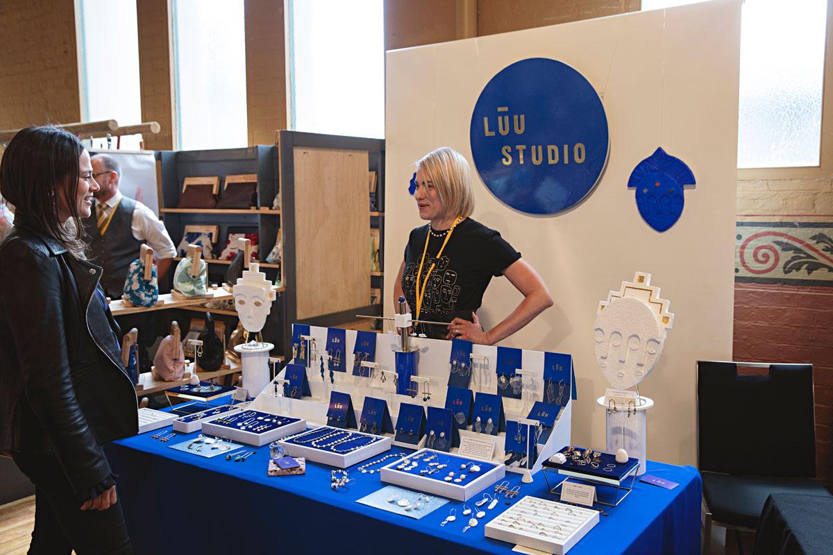 Renee talking to stallholder Luzette Godinez of Luu Studio at design market finders keepers